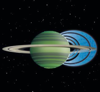 Foto di Saturno in cui sono visibili le bande scure causate dalla pioggia